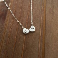 Keeping it simple and cute!  hand stamped initials on heart charms by DreamWillowStudio on Etsy