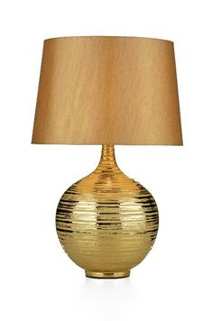 The DAR lighting Gustav table lamp has a bottle neck style gold glazed ceramic base with complimenting faux silk shade. Suitable for use with low energy lamps. Full range of table and floor lamps available from Luxury lighting.
