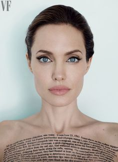 Angelina Jolie Vanity Fair - December 2014 - photo by Mario Testino - The opening words to 'Unbroken' on her chest.
