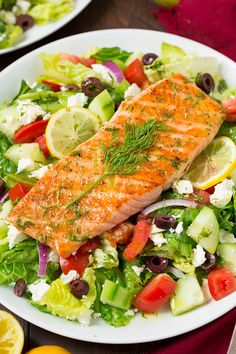 I love a good Greek salad with a vibrant lemon vinaigrette and salmon is one of my favorite dinners, so why not put the two together? I eat so many chicken salads but I decided it was time to switch t