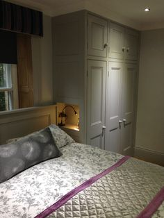 Fab little cubby hole for a light, book, night time treasures instead of a bedside table in this grey bedroom.  Incorporated into fitted wardrobes by Dunham Fitted Furniture to make best use of the space and to create the cosiest bedroom area!