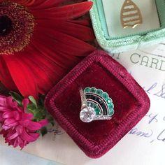 Emerald, onyx, and diamond ring
