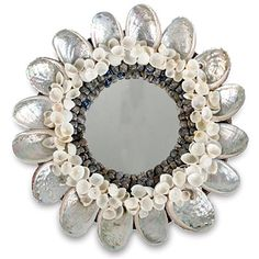 Add whimsical flair to a room with this Abalone Shell Mirror  $30, www.jaysonhomeandgarden.com