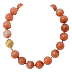 "NICHOLAS VARNEY Carnelian Beads with Gold and Diamond Ball Clasp US 1980'sw New York artist jewelry designer, Nicholas Varney, created this wonderful combination of large, beautifully colored carnelian beads with a gold and diamond ball clasp. The beads are 20 mm; the necklace is 18 3/4"" long. It is from the collection of Paige Rense, editor emeritus of Architectural Digest."