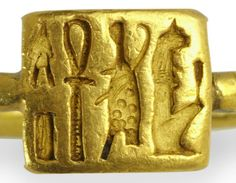 """Egyptian Gold Finger Ring, Late Period, 664-332 BC Engraved with a cryptographic hieroglyphic motto reading: """"Sekhmet is Beautiful; The Apis Bull Lives"""""""