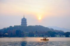 Let's sit together and watch the sun greet the sky #hangzhou #west lake #china #asia #travel #explore #history #outdoors #photography #west lake #sunrise