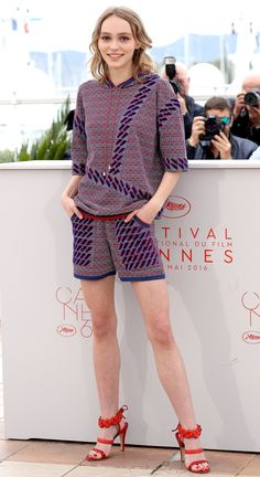 LILY-ROSE DEPP in a red, blue and purple Chanel sweat-shorts-suit and red floral Chanel heels for the Dancer photocall.
