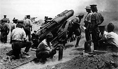 A British 60 pounder Mk I battery, one of the very few heavy guns at Gallipoli, in action on a cliff top at Cape Helles, Gallipoli, possibly in June 1915.