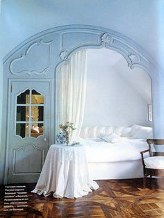 Axel Vervoordt ~ gorgeous blue alcove bed