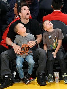 SEE IT TO BELIEVE IT | Must've been some play! Mark Wahlberg and sons Brendan, 5, and Michael, 8, look on in wonder as they take in Tuesday's matchup between the New York Knicks and the Los Angeles Lakers at the Staples Center, where the home team bested the competition 127-96.
