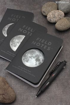 Field Notes Lunacy Memo Books have die-cut covers that reveal the moon in three phases and light gray, dot grid paper.