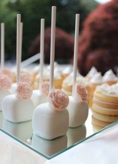 Rose topped cake pops at a baptism party! See more party planning ideas at CatchMyParty.com!