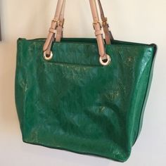 Michael Kors Green patent leather tote Brilliant green patent leather Michael Kors tote with light tan 9 inch drop handles adjustable. Other than minor marks inside lining perfect condition! Michael Kors Bags Totes