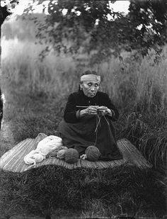 Tulalip woman named Magdeline Whea-kadim knitting, Tulalip Indian Reservation, Washington, 1906