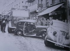 Car crash on Wyle Cop 1940, you can see the Nags Head just behind the pile up. Shrewsbury, Shropshire.  Vintage vehicles