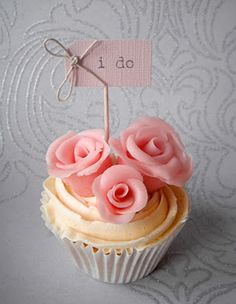 Adorable 'I Do' Pink Rose Wedding Cupcake http://thecupcakedailyblog.com/adorable-i-do-wedding-cupcake/