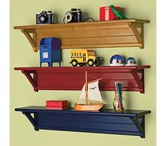 """Land of Nod Kids' Shelves: Kids Mounting Wall Shelves - we're looking for little display shelves for characters and other """"treasures"""". ONly wish the area under these shelves had hooks or something practical..."""