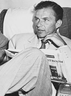 Ol' Blue Eyes reads. francisalbertsinatra:  Frank Sinatra on a flight from New York to London, 1950