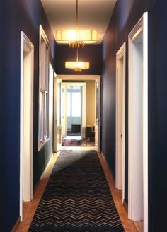 Dark blue walls, were painting our living room this color, less baby mess than the color white