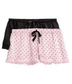 Let her lounge to her heart's content with this pair of black & pink satin pajama shorts with lace trim and elastic waist. | H&M Gifts