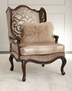 """Handcrafted wing chair. Mahogany frame. Cotton/viscose upholstered inside back; leather seat cushion; polyester outside back. 32""""W x 38""""D x 49""""T. Seat, 22""""W x 24""""D x 20""""T; arms, 27""""T. Includes decorat"""