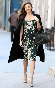 Shop Miranda Kerr's look for $97:  http://lookastic.com/women/looks/black-overcoat-and-black-bodycon-dress-and-black-handbag-and-silver-heels/1819  — Black Overcoat  — Black Floral Bodycon Dress  — Black Leather Handbag  — Silver Heels
