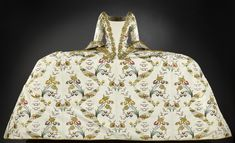Bodice and train of woman's court mantua, in cream silk brocaded in gold and coloured silks with floral design, bodice with open front and elbow length sleeves, lined in linen: c. 1750 - 1770