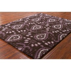 @Overstock.com - Transform your home decor with a stylish Mandara rug. Area rug is hand-tufted in India and made of 100-percent Imported wool and features an allover abstract design highlighted in shades of purple and ivory against dark brown mix background.http://www.overstock.com/Home-Garden/Mandara-Hand-tufted-Abstract-Wool-Rug/7310554/product.html?CID=214117 $182.74