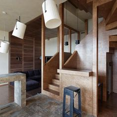 Russian architect Peter Kostelov has slotted a timber structure into a two-storey apartment in Moscow to create two extra floors.