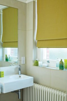 Add a blast of colour into your bathroom with our roman blinds range. #romanblinds #greenblinds #home #interiordesign #bathroomblinds Please visit us at www.barnesblinds.co.uk Blinds For You, Bathroom Blinds, Window Types, Roman Blinds, Roman Shades, Range, Windows, Curtains, Doors