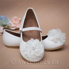 843be8e4659b This lovely flat shoe has a delicate white flower and jewel accent. Perfect  accessory to