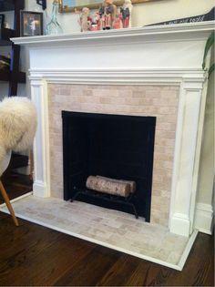 Finito. Travertine subway tile fireplace. #TheFan