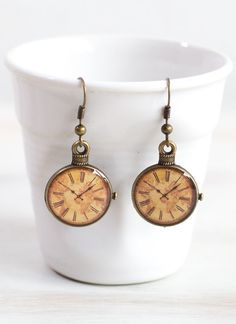 Hey, I found this really awesome Etsy listing at https://www.etsy.com/listing/212130930/brass-clock-earrings-antique-map