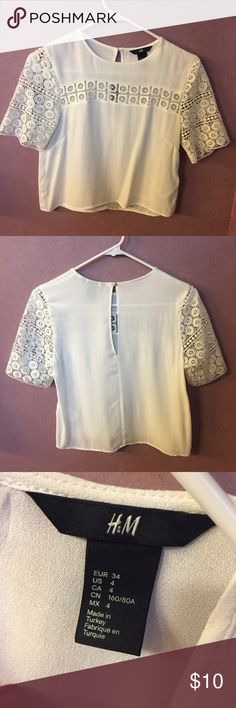 H&M Crop Lace Shirt Adorable white H&M shirt, slightly cropped length but not full crop top. Lace details on sleeve and at neckline. Super cute and like new!! H&M Tops Blouses