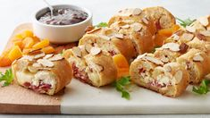 Thanks to this genius recipe, you can enjoy all your favorite flavors from a pub-style cheeseboard in every bite. Inspired by this Bake-Off® finalist's cheeseboard order on a trip to Dublin, this creative appetizer features creamy honey goat cheese, white cheddar and flavorful salami baked to perfection inside our Pillsbury™ French bread. Served alongside classic cheeseboard accompaniments like dried apricots, arugula and fig preserves, this wow-worthy appetizer is a guaranteed hit at any......