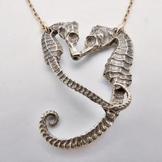 Seahorse Necklace, Gold Fill. Love that they create a heart shape.