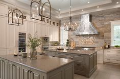 Double islands, floor-to-ceiling cabinetry and a grand range hood are just some of the must-see features in NAHB's New American Remodeled Home in Orlando, FL. #woodmode #customcabinets