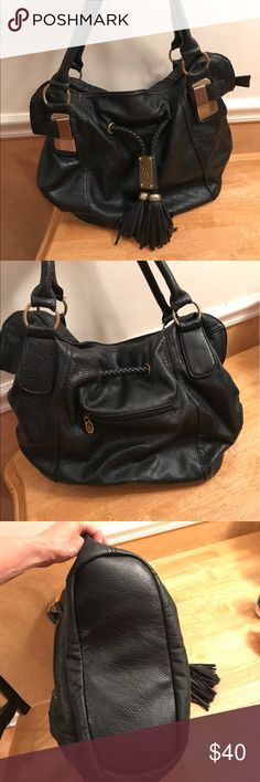 Excellent condition gorgeous boho bag Carried for 2 or 3 months! In like new condition. Black soft black bag w/ black tassels and gold detailing. vitalio Bags Shoulder Bags