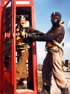 Royalty Free Pictures of World War II , Airmen hamming it up for the camera at an English phone booth.