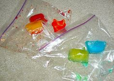 Put several colors of food coloring into a container of ice cubes. When they are frozen, place two colorful ice cubes into a ziploc bag and give a bag to each child. Talk with your preschooler about mixing color combinations, and let your toddler enjoy the sensation of pushing the ice cube around the bag.