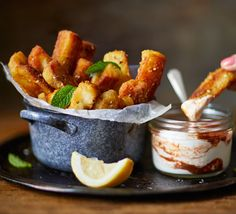 Crisp and slightly salty deep-fried halloumi fries make perfect party food. Great with a sprinkling of za'atar and a spicy yogurt for dipping