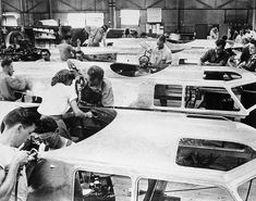 B-17 cockpits being assembed at Seattle Plant 1942 by women and male workers of Boeing.