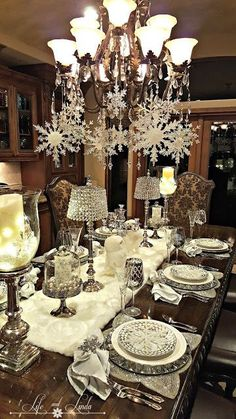 Christmas table decorations for those one of a kind Christmas parties are fun and easy to make. If you do plan on making your own Christmas table decorations, they can be time consuming and if you have a dozen or… Continue Reading → Christmas Table Settings, Christmas Tablescapes, Christmas Table Decorations, Decoration Table, Holiday Decor, Holiday Tablescape, Centerpiece Ideas, Christmas Chandelier Decor, Seasonal Decor