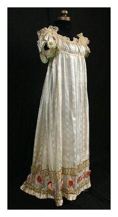 Directoire-period fancy silk evening dress with metallic trim, c.1800.  High-style fashion with distinctive detail work.    The sleeves are a work of art: outlined with green silk corded binding and scallops of gold bullion.