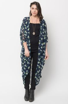 http://www.caralase.com/floral-maxi-kimono/ Floral Maxi Kimono Wrap is intricately designed with its shoulder pleats and use of artfully patterned, color-drenched fabric that are as vibrant as they are easy to wear. #floralmaxikimono #maxikimono #floralmaxi #floralkimono #floralkimonocardigan