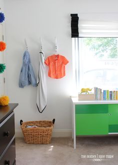 White hooks on a white wall make for simple and streamlined storage