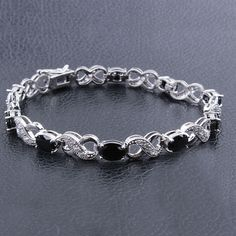 A gorgeous black sapphire, and diamond, infinity set will have all eyes on you!  Buy today for under $30!