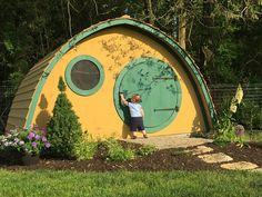 Adult sized multiuse Hobbit Hole outdoor wooden garden shed, guest cabin, tea room, pool house with round and square doors, screen windows
