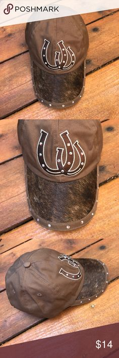 Western Cap Have Luck On Your Side When You Wear This Chic Western Horseshoe Cap! One size fits most. Worn once if that. EUC. Color is brown with 2 horse shoes on front with faux iridescent jewels that play off the light beautiful. Same jewels around brim with shades of brown real calf hair. Adjustable Velcro strap in back. 80% cotton. 20% calf hair. NO TRADES. Accessories Hats