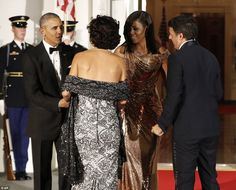 President Barack Obama and first lady Michelle Obama greet the Italian Prime Minister Matt...